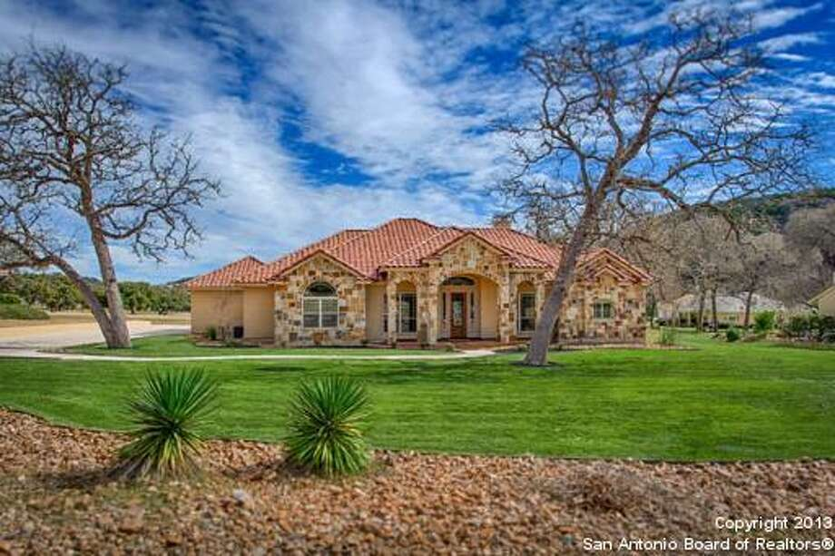 This golf lovers' perfect Texas Tuscan home overlooks a golf course and  sparkling pool. 3 Bedrooms, 2 Full Baths, 1 Partial Baths, 2,848 Sq Ft,  MLS: 1019283 Photo: Courtesy