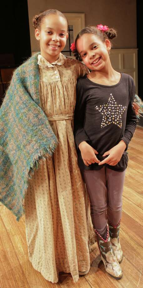 """Liliane Moon, 11, and her sister Leila, 8, alternate in the role of Jessa, a young slave girl in """"A Civil War Christmas."""" Main Street Theater is presenting the regional premiere of Paula Vogel's show subtitled, """"An American Musical Celebration."""" Photo: Art Ornelas / ricornelproductions"""