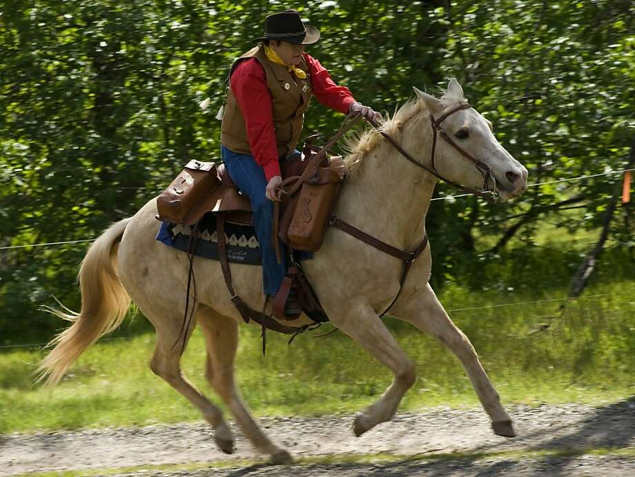 Jessie Davison of Placerville re-creates a Pony Express ride in 2010. Photo: Janet Fullwood, Special To The Chronicle
