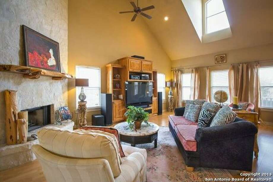 Bright and open floor plan with Pergo flooring, great room with a floor-to-ceiling