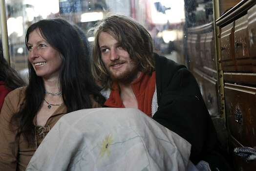Gypsy Taub and her fiance Jaymz Smith sit under blankets as the family watches South Park at their home in Berkeley, CA, Friday, December 13, 2013.   Nudity activists Gypsy Taub and her fiance Jaymz Smith are planning a naked wedding on the steps of San Francisco City Hall on Dec. 19. Photo: Michael Short, The Chronicle