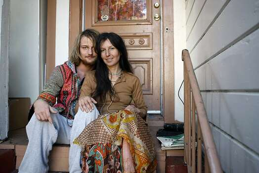 Gypse Taub, right, and her fiance Jaymz Smith sit for a portrait on the front steps of their home in Berkeley, CA, Friday, December 13, 2013.   Nudity activists Gypsy Taub and her fiance Jaymz Smith are planning a naked wedding on the steps of San Francisco City Hall on Dec. 19. Photo: Michael Short, The Chronicle
