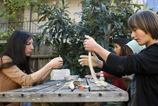 (L-R)Gypsy Taub works on a clay project with her children Inti, 13, Daniel, 8 and Nebosvod, 10, as part of their home schooling in the backyard of their home in Berkeley, CA, Friday, December 13, 2013.   Nudity activists Gypsy Taub and her fiance Jaymz Smith are planning a naked wedding on the steps of San Francisco City Hall on Dec. 19. Photo: Michael Short, The Chronicle