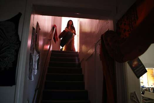 Gypsy Taub carries blankets down from an upstairs bedroom at their home in Berkeley, CA, Friday, December 13, 2013.   Nudity activists Gypsy Taub and her fiance Jaymz Smith are planning a naked wedding on the steps of San Francisco City Hall on Dec. 19. Photo: Michael Short, The Chronicle
