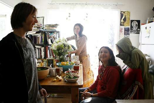 Gypsy Taub, center, with her children (L-R)Nebosvod, 10 , Inti, 13, and Daniel, 8, get ready to eat lunch in the kitchen of their home in Berkeley, CA, Friday, December 13, 2013.   Nudity activists Gypsy Taub and her fiance Jaymz Smith are planning a naked wedding on the steps of San Francisco City Hall on Dec. 19. Photo: Michael Short, The Chronicle