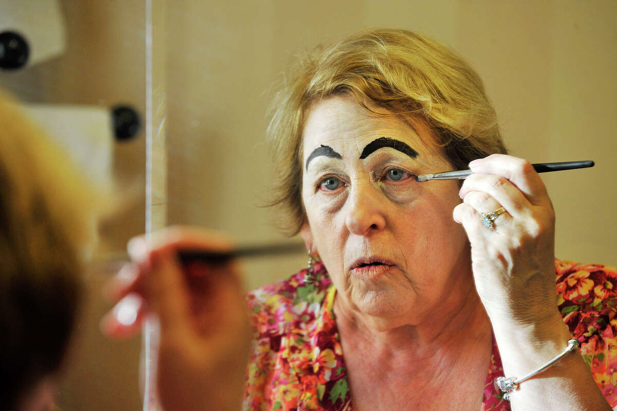 Lorraine Kweskin puts on clown makeup before demonstrating how she plays Nurse Morning Glory, a clown character, at her home in Stamford, Conn., on Monday, Nov. 25, 2013. Kweskin is a volunteer with The HAHA Clowns at Stamford Hospital. HAHA stands for Health And Humor Associates.