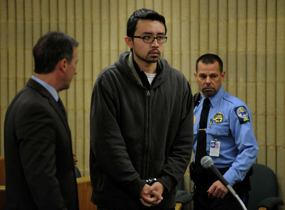 Standing with his lawyer, Fred Paoletti, left, University of New Haven student William Dong, 22, of Fairfield, appears at Superior Court in Milford, Conn. on Tuesday, December 17, 2013. Photo: Brian A. Pounds / Connecticut Post