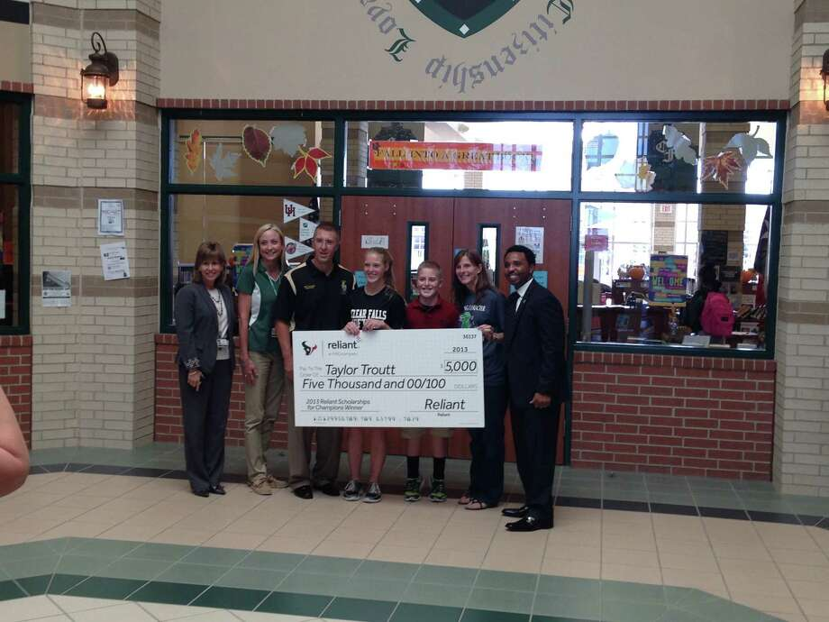 Helping Taylor Troutt to celebrate her scholarship award were, from left, Karen Engle, principal; Dava West, Taylor's counselor who submitted the scholarship nomination; Mike Troutt, her father; Taylor Troutt, scholarship winner; Michael Troutt, her brother; Tricia Troutt, her mother, and JJ Moses, Houston Texan Ambassador and former Texans player.