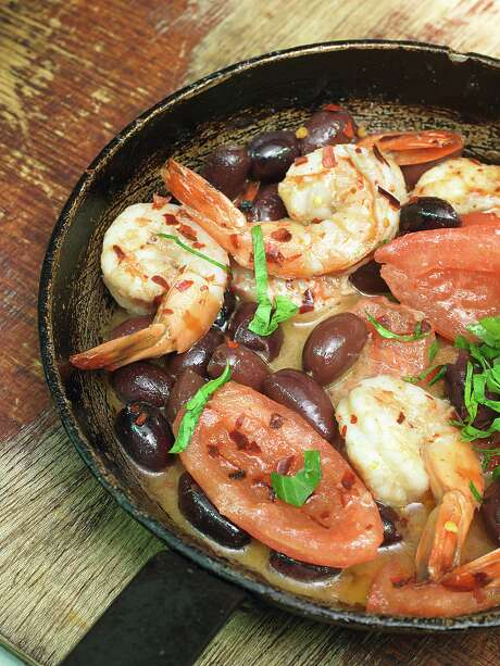 """Buttered Prawns with Tomato, Olives, and Arak from """"Ottolenghi: The Cookbook"""" by Yotam Ottolenghi and Sami Tamimi (Ten Speed Press) Photo: Ten Speed Press / Ten Speed Press"""