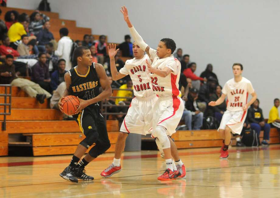 Clear Brook senior guards Chase Mason (5) and Jovan Yancy (22) teamed up to defend against Alief Hastings' Shawn Johnson (41). The Wolverines guard-heavy lineup is quick and can pressure opponents into turnovers. Photo: Jerry Baker, Freelance