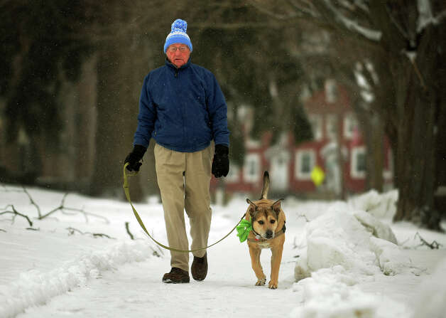 Jim Coffey, of Milford, takes his dog Tobey for a snowy walk along West River Street in downtown Milford, Conn. on Tuesday, December 17, 2013. Photo: Brian A. Pounds / Connecticut Post
