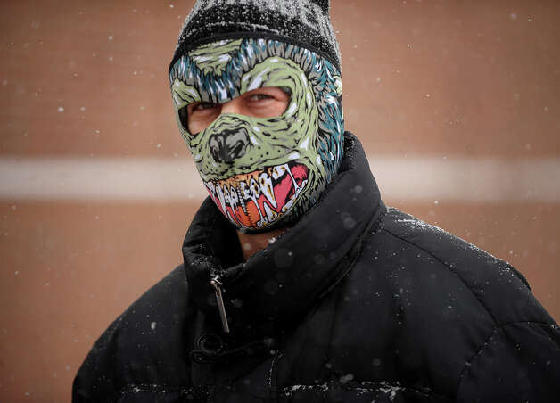 A scary face mask helps a man keep warm on West River Street in downtown Milford, Conn. on Tuesday, December 17, 2013. Photo: Brian A. Pounds / Connecticut Post
