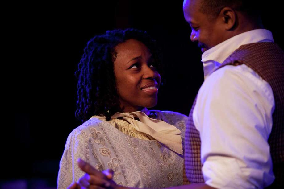 "Crystal Rae, shown with Shawn Hamilton, portrays a runaway slave in "" A Civil War Christmas."" Marie D. De Jeséºs / Houston Chronicle Photo: Marie D. De Jeséºs, Staff / © 2013 Houston Chronicle"