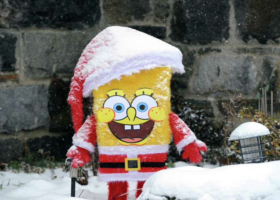 A snow-covered SpongeBob Squarepants figure sports a smile on the front lawn of a St. Roch Avenue home during the snow storm that hit Greenwich, Conn., Tuesday afternoon, Dec. 17, 2013. Photo: Bob Luckey / Greenwich Time