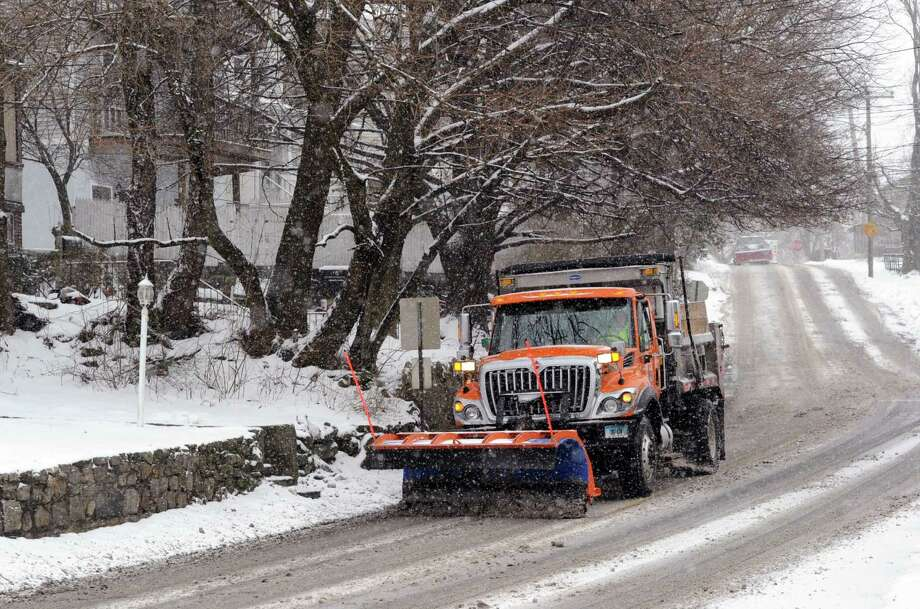 A plow truck clears Byram Road during the snow storm that hit Greenwich, Conn., Tuesday afternoon, Dec. 17, 2013. Photo: Bob Luckey / Greenwich Time