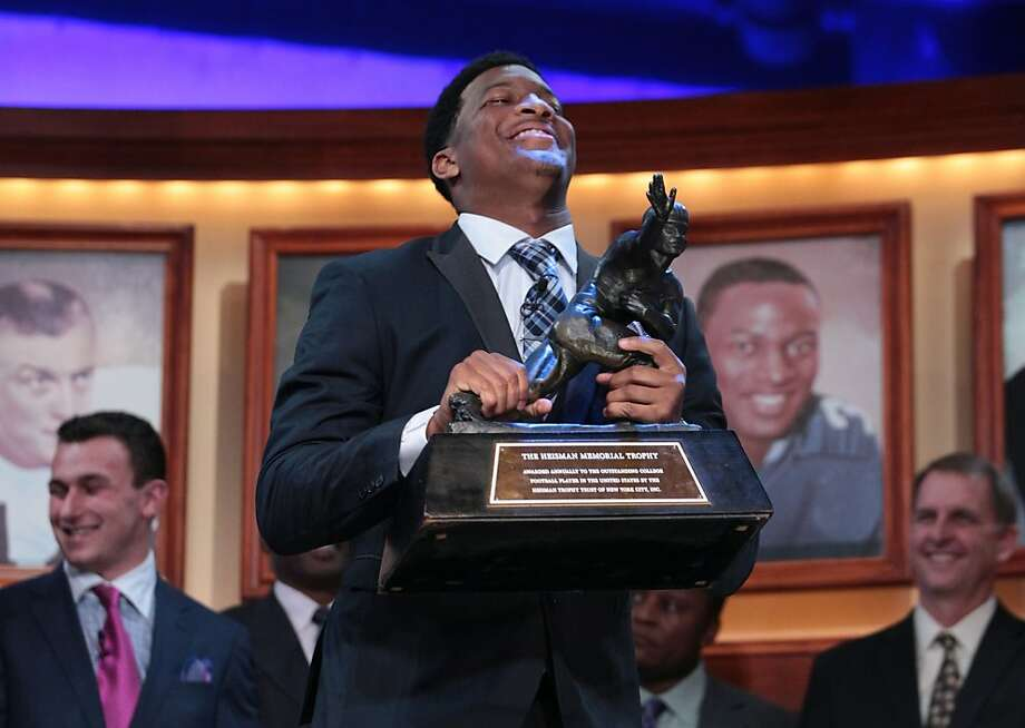 Florida State quarterback Jameis Winston is awarded the Heisman Trophy in New York. Photo: Kelly Kline, Associated Press
