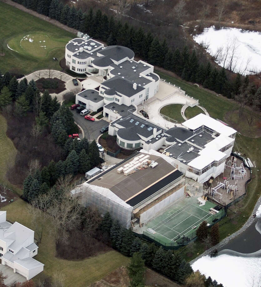 FILE - This Jan. 8, 2002 aerial file photo shows the home of former Chicago Bulls star Michael Jordan, in Highland Park, Ill. Jordan's 56,000-square foot home in suburban Chicago is up for auction. Concierge Auctions says the sale will take place Monday, Dec. 16, 2013. The company runs the sales of high-end real estate and features Jordan's Highland Park home north of Chicago on its website. Photo: Ted S. Warren, AP / AP