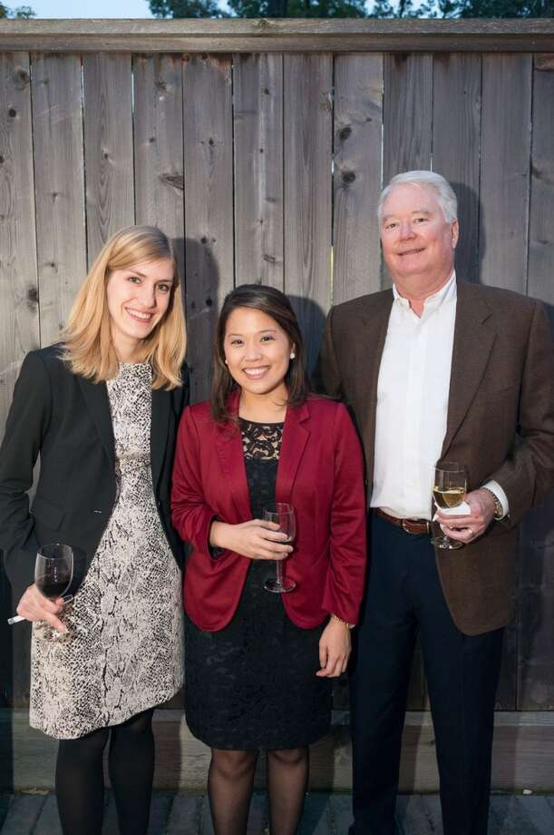 Lindsey Roskopf, Vicky Wu, Alec Mize partying at the Houston District Export Council Holiday party, Dec. 12, 2013. Photo: Logan Beck, Logan Beck Photography