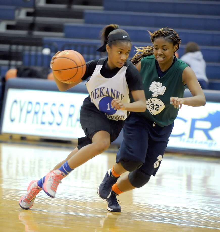 Dekaney's Jaelyn Richard-Harris, left, has led the Wildcats at point guard this season. Photo: Eddy Matchette, Freelance / Freelance