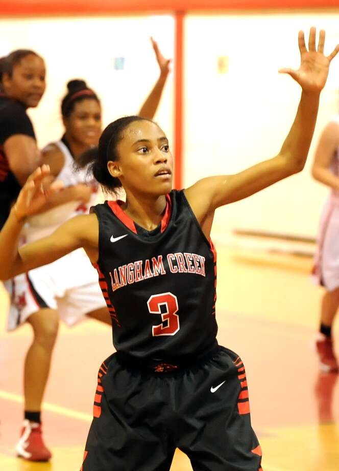 Mercedes Busby (3) has emerged as a strong defensive guard for the Lobos. Photo: Eddy Matchette, Freelance / Freelance