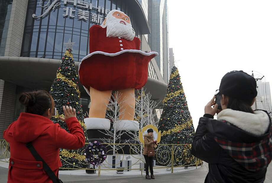 "Jolly ol' St. Knickers:The giant Santa Claus at a department store in Taiyuan, China, is having the same problem that Marilyn Monroe had in ""The Seven-Year Itch."" Photo: Associated Press"