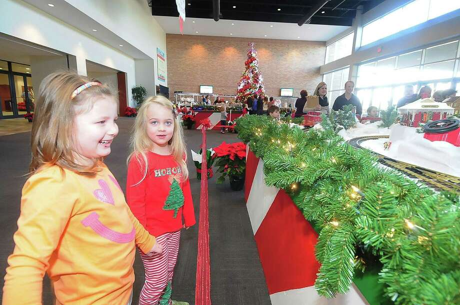 Five-year-olds Mya Johnson and Abigail Ingram enjoy the holiday train exhibit at Second Baptist Church West Campus. Photo: Â Tony Bullard 2013, Freelance Photographer / © Tony Bullard & the Houston Chronicle