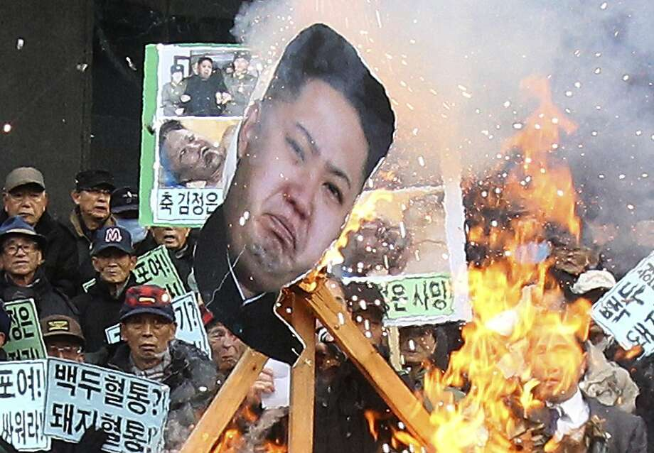 Un flammable:In Seoul, protesters burn a poster of Kim Jong Un during an anti-North Korea rally on second anniversary of the 