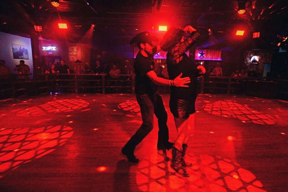 A couple dances on the new remolded floor of The River on Wednesday while Jamie Talbert and the Band of Demons perform. Former Whiskey River has been remodeled, rebranded and is now The River. Michael Rivera/@michaelrivera88