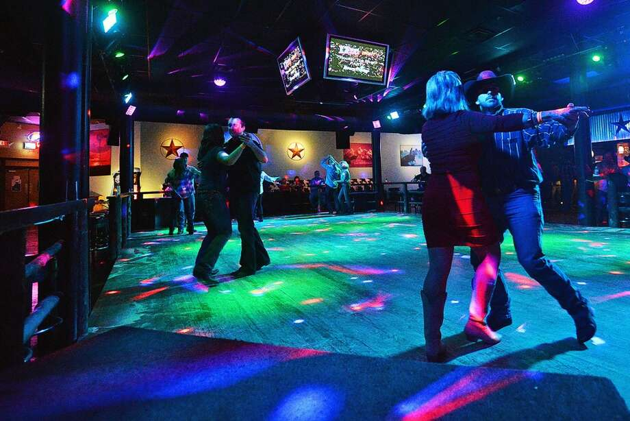 Pairs of dancers dance on the new remolded floor of The River on Wednesday while Jamie Talbert and the Band of Demons perform. Former Whiskey River has been remodeled, rebranded and is now The River. Michael Rivera/@michaelrivera88