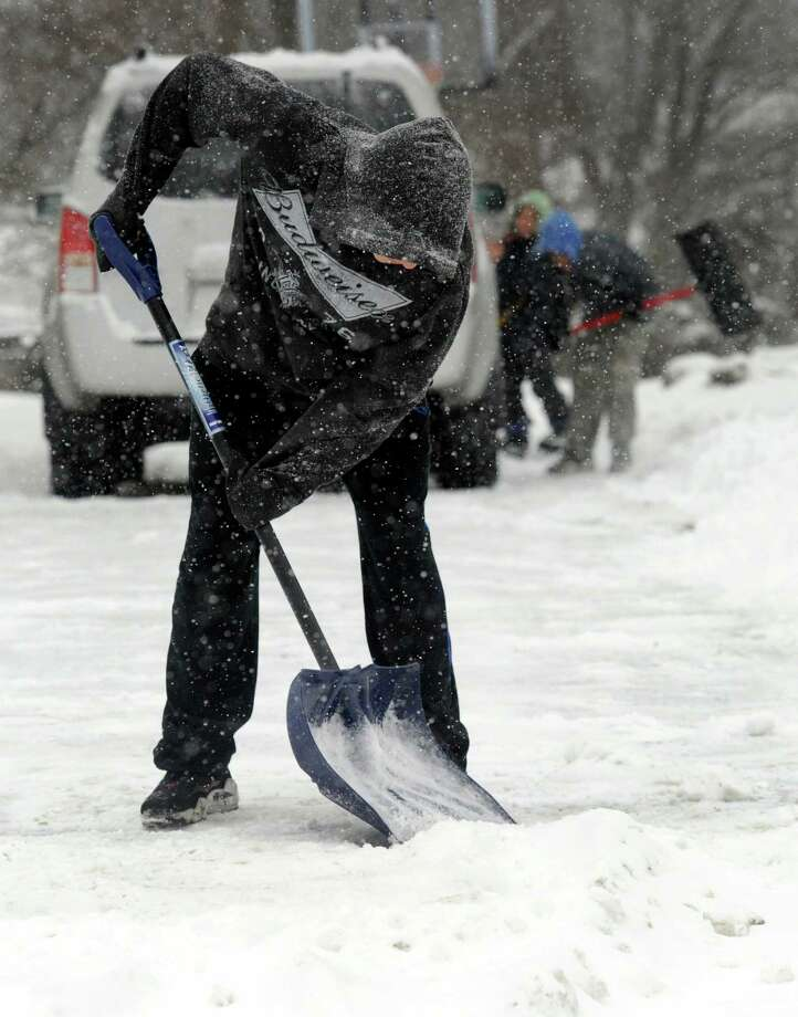Jerjes Almamzar, 16, shovels the driveway at his family's home in Danbury, Conn. Tuesday, Dec. 17, 2013. Photo: Carol Kaliff / The News-Times