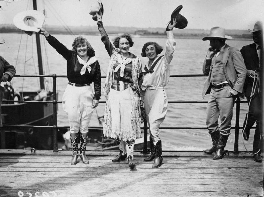 Three cowgirls in 1924,  waving from the deck of the steamship Menominee as it nears London along the River Thames, on the last leg of its journey. The 'rodeo ship' is bringing cowboys and horses from America to take part in a Rodeo at Wembley. Photo: Kirby, Getty Images