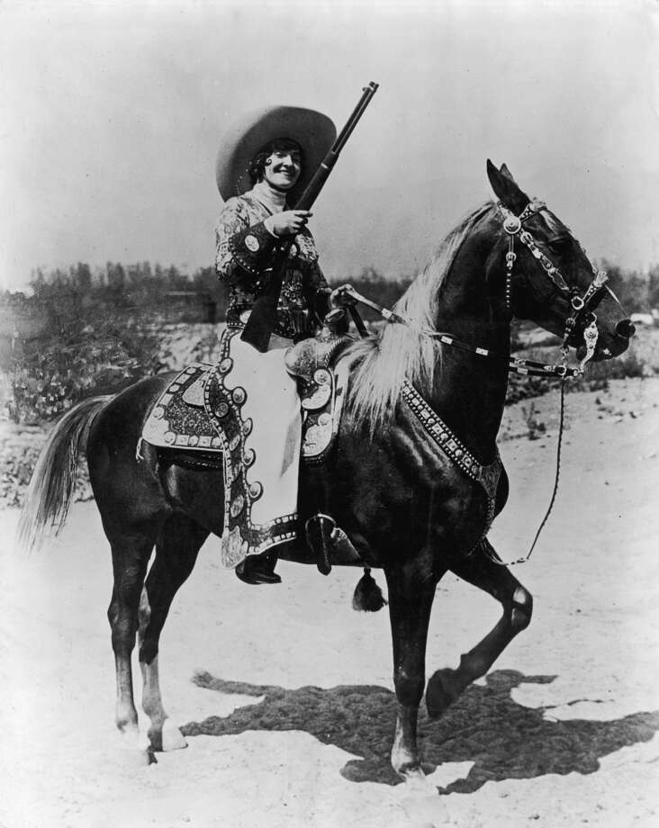 Portrait of Mrs Maude Musick wearing an elaborate gold repousse riding ensemble on horseback with a matching saddle and bridle, the complete outfit cost $20,000, 1925.  Photo: Orville Logan Snider, Getty Images