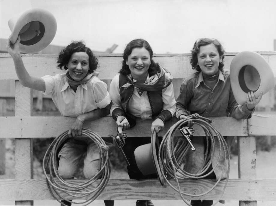 At a rodeo, from left, Cecelia Ashadina, Aleen Thompson, and Dorothy Abbott lean on a railing and pose for a picture, 1930s. Photo: FPG, Getty Images