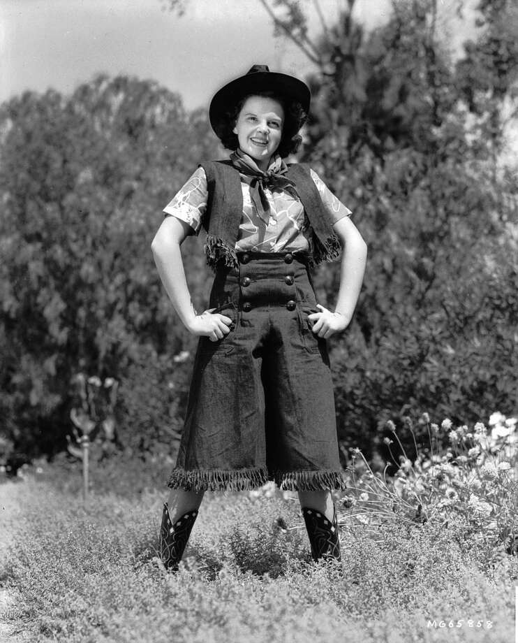 Singing film star Judy Garland (Frances Ethel Gumm) (1922 - 1969) wearing a western-style costume in 1937.  Photo: John Kobal Foundation, Getty Images