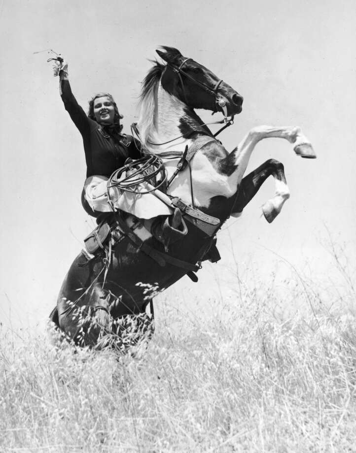 Portrait of rodeo champion and actor Betty Miles (1910 - 1992) riding a bucking horse, 1945.  Photo: DeMauro, Getty Images