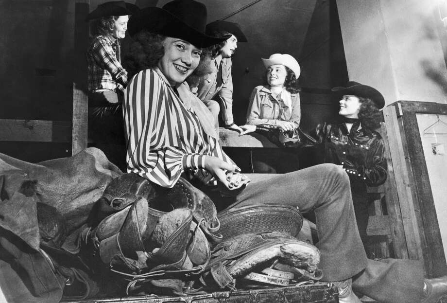 18 year-old Texan cowgirl Ora Mae Clark with colleagues backstage at a rodeo held in Madison Square Garden, New York, circa 1945. Photo: FPG, Getty Images