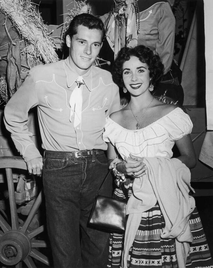 British-born actor Elizabeth Taylor and her first husband, hotel heir Conrad 'Nicky' Hilton Jr, attending a charity event for blind children, Beverly Hills Hotel, California, 1951.  Photo: Murray Garrett, Getty Images