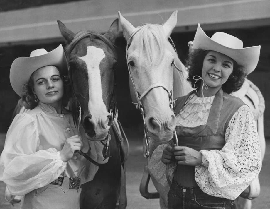 Two American cowgirls and their horses in London for the Texas Rodeo show at Harringay, 1952.  Photo: Reg Speller, Getty Images