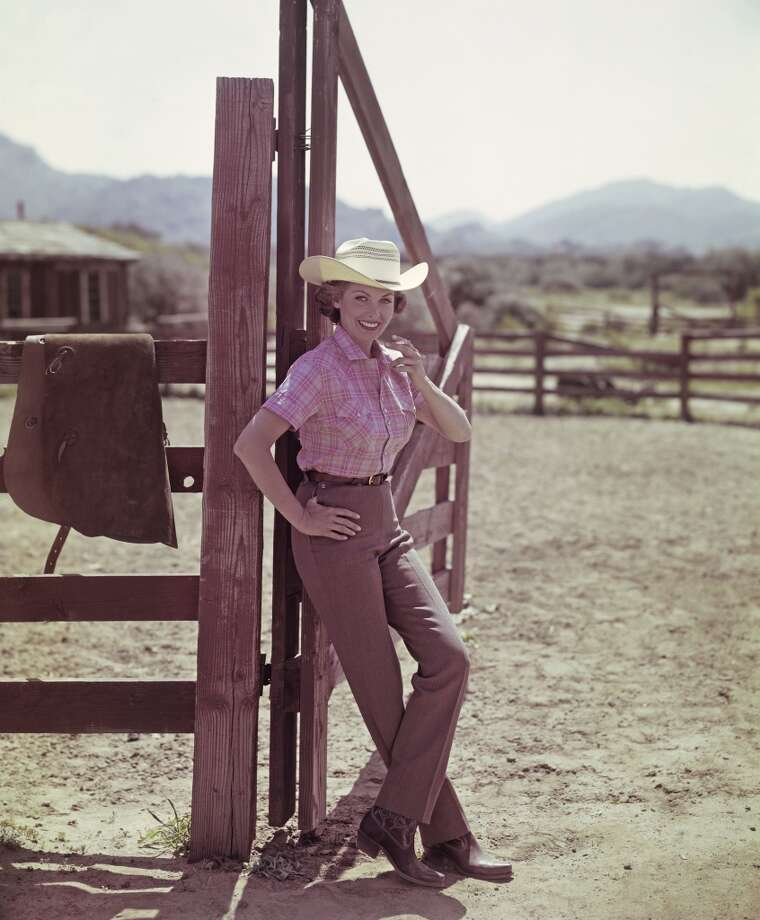 A cowgirl smiles while smoking a cigarette in a corral, Chatsworth, CA, 1954. Photo: Tom Kelley Archive, Getty Images