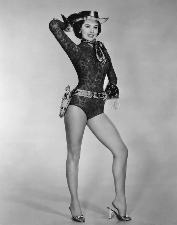 American actor and dancer Cyd Charisse wearing a costume leotard with a cowgirl hat in a promotional portrait for director Roy Rowland's film, 'Meet Me in Las Vegas,' 1956.  Photo: Hulton Archive, Getty Images