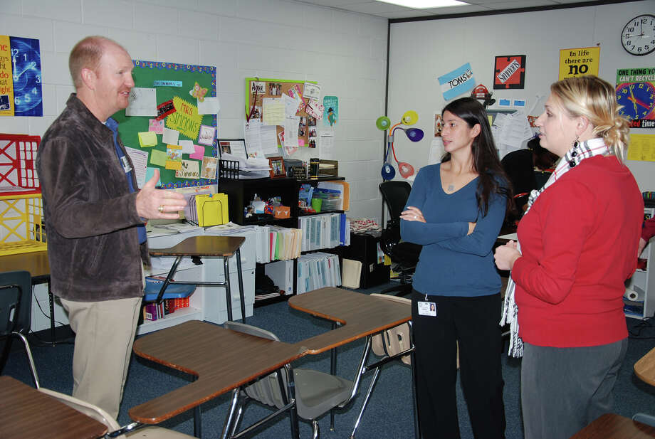 Chuck Chauviere of GE Oil and Gas discusses classroom technology with teachers Tiffani LaRose and Monica Falk at Cy-Fair High School. Photo: Provided By Cy-Fair High School