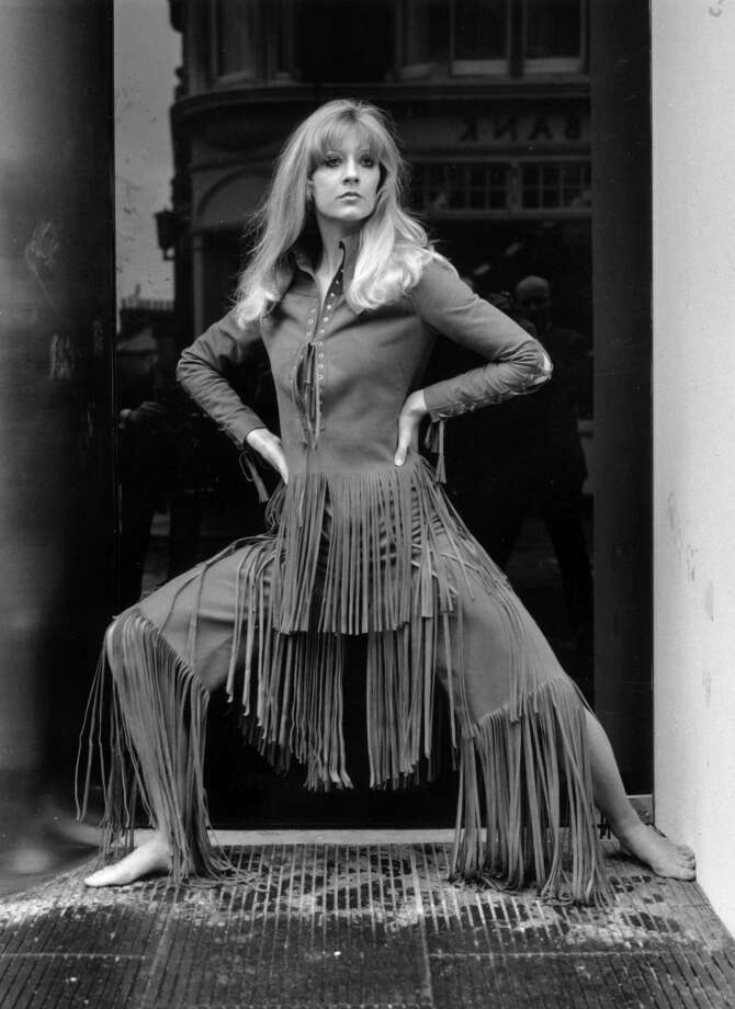 Vicki Hodge models 'Marisa', a rough suede trouser suit with long fringe, part of the Ossie Clark and Alice Pollock collection on show at the Querum boutique on London's King's Road, 1969. Photo: Bob Aylott, Getty Images