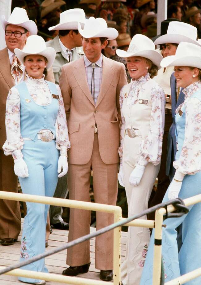 The Prince of Wales with cowgirls in Calgary, Canada in 1977. Photo: Anwar Hussein, WireImage