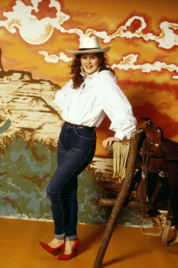 Posed studio portrait of Kirsty MacColl, cowgirl, 1981. Photo: Fin Costello, Redferns