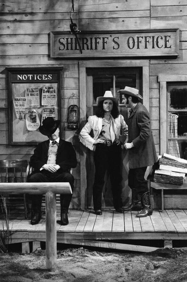 Edwin Newman as Kid Halpern, Julia Louis-Dreyfus a cowgirl, and Gary Kroeger as cowboy during the 'How High The Noon' skit on February 25, 1984 Photo: NBC, NBC Via Getty Images