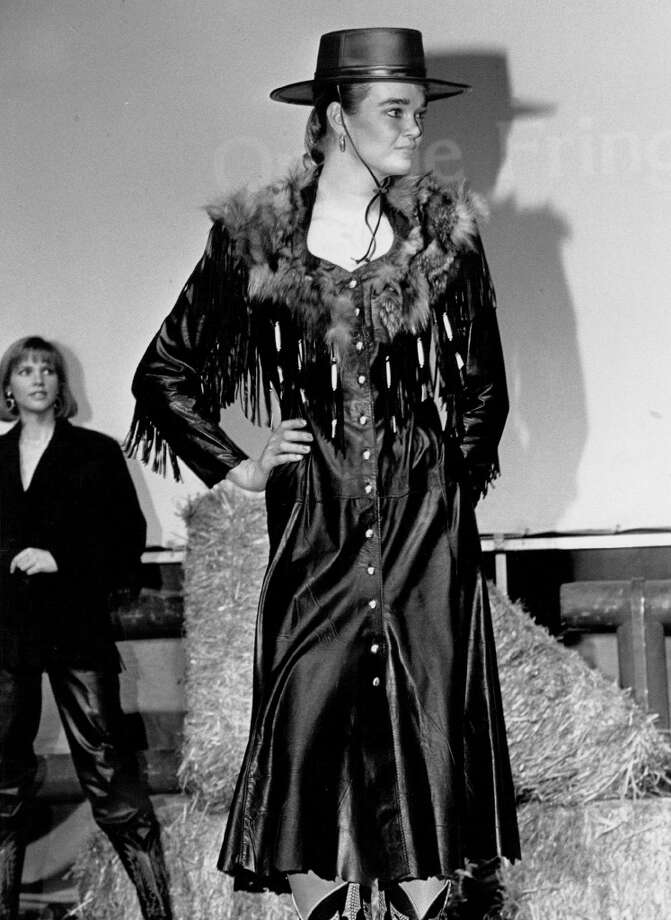 "Stock show fashion show leather and feathers in black; outfit suitable for "" pretend"" cowgirl;  1989. Photo: Lyn Alweis, Denver Post Via Getty Images"