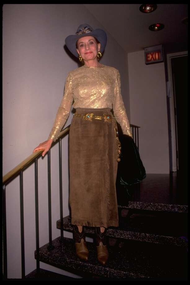 Newswoman Barbara Walters wearing a cowgirl outfit complete with hat, as she stands on staircase, 1994. Photo: David McGough, Time & Life Pictures/Getty Image