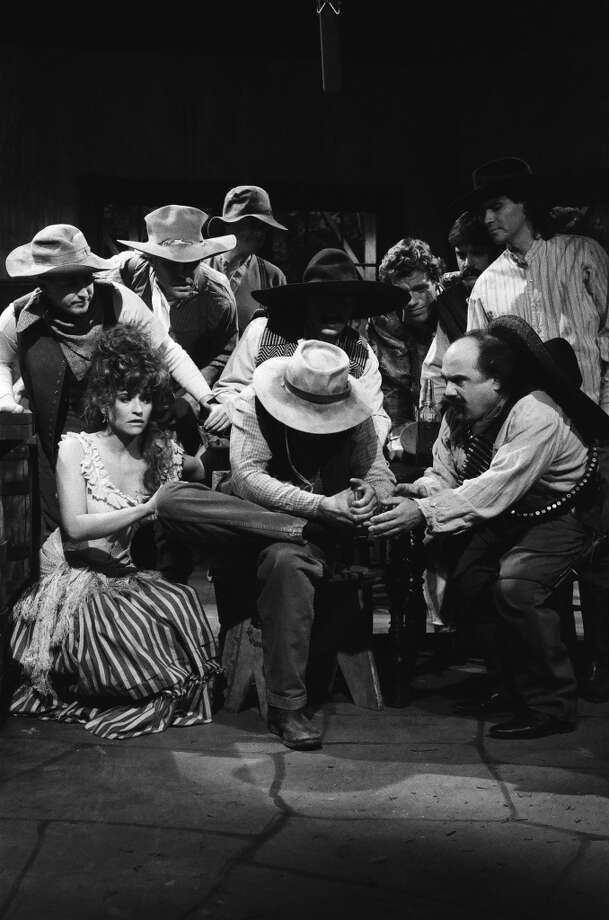 "Jan Hooks as cowgirl, Jon Lovitz as victim, Dennis Miller as cowboy, Danny DeVito as Gariton during the 'You Shot Me!' skit on December 3, 1988 on ""Saturday Night Live."" Photo: NBC, NBC Via Getty Images"