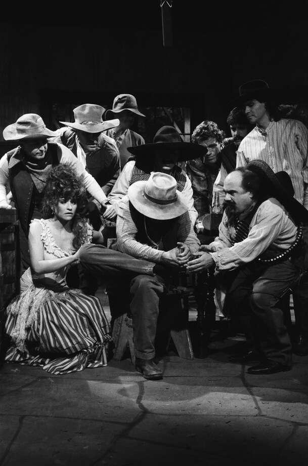 "Jan Hooks as cowgirl, Jon Lovitz as victim, Dennis Miller as cowboy, Danny DeVito as Gariton during the 'You Shot Me!' skit on December 3, 1988 on ""Saturday Night Live."" Photo: NBC, NBC Via Getty Images"