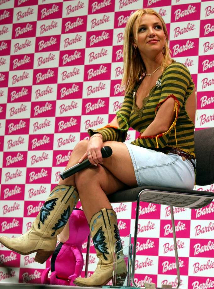 Pop singer Britney Spears sits onstage at a Barbie Award ceremony April 21, 2002 in Tokyo, Japan. Photo: Koichi Kamoshida, Getty Images